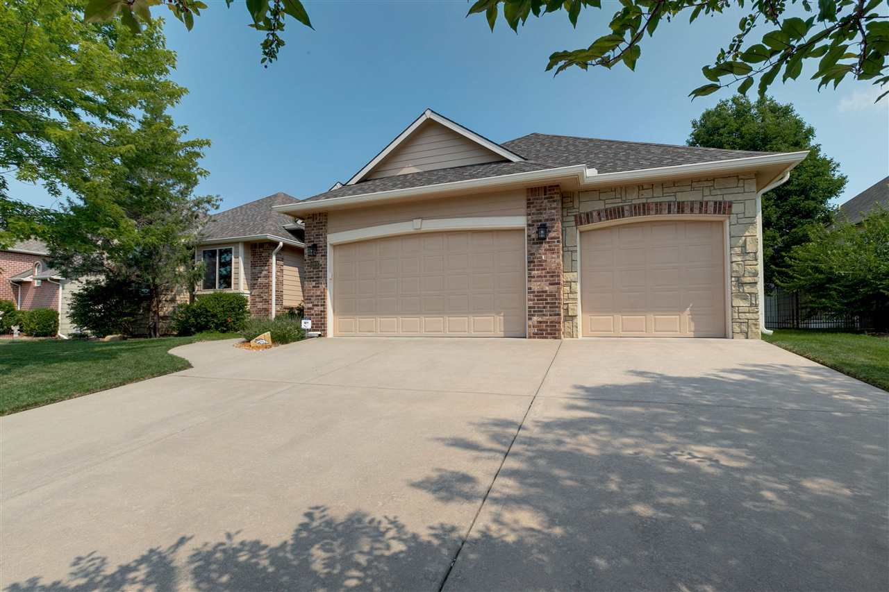 This stunning home is located in the perfectly placed, quiet neighborhood of northeast Wichita in Re