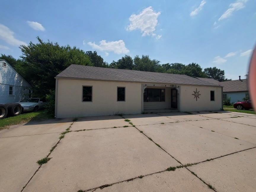 This house is such a unique find in North Wichita! The floorplan has over 2300 Square feet and almos
