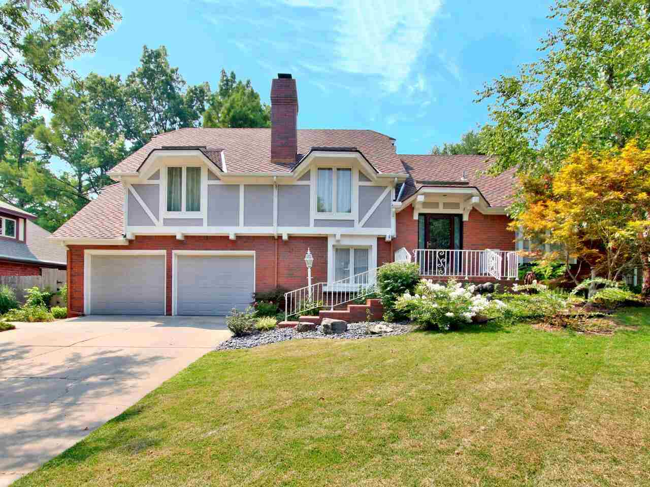 Welcome to this amazing split-level Tudor in the quiet Brookhollow neighborhood. Take in the tranqui