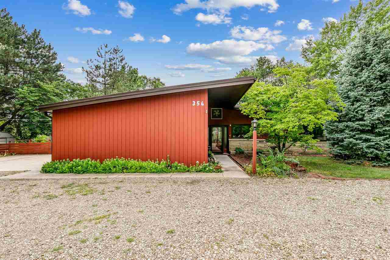 A true mid-century modern home on one acre with a pond in East Wichita awaits its new owner.  This 3