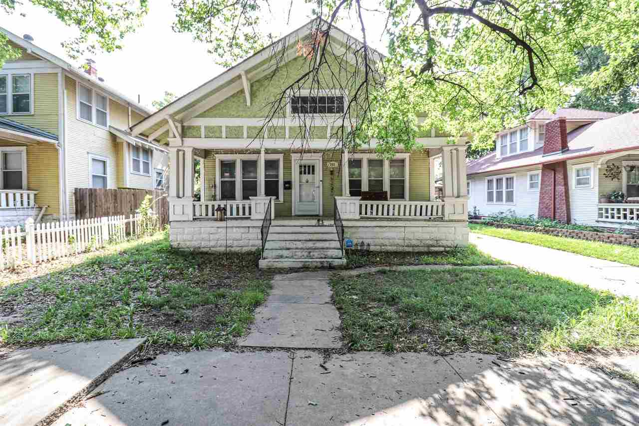 Make yourself at home at this charming four bedroom, one bath bungalow. Built in 1915, this home has