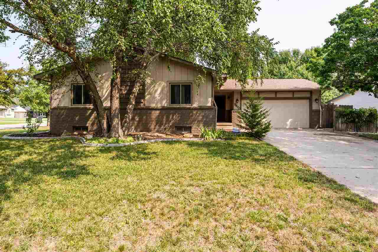 Beautifully updated and well maintained home! Mature trees and lovely flower beds accentuate this la