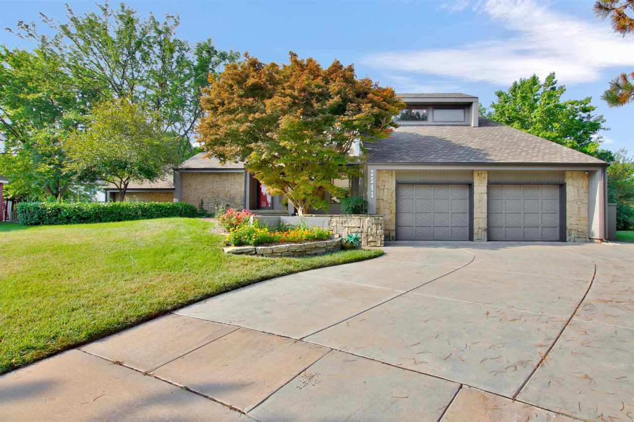 What a fabulous Tallgrass location!  On a quiet cul-de-sac, lot opens onto Tallgrass golf course!  Almost 4,000 sq ft on a third of an acre.  New roof 2020, new carpet and paint 2021!  26x13 granite kitchen with all stainless appliances that will stay.  Formal living room with floor to ceiling stone 2 story fireplace and soaring wood vaulted ceiling.  Spacious formal dining room plus eating space in the kitchen.  Ground floor laundry with work sink.  Master suite up with additional vaulted ceilings, stone fireplace sitting room, open master bedroom with his and hers walk-in closets, jetted tub and separate shower.  Basement family room wired for surround sound.  Large wood deck with seating and an additional patio.  Watch the Kansas sunset over the Tallgrass Golf Course from your peaceful backyard!