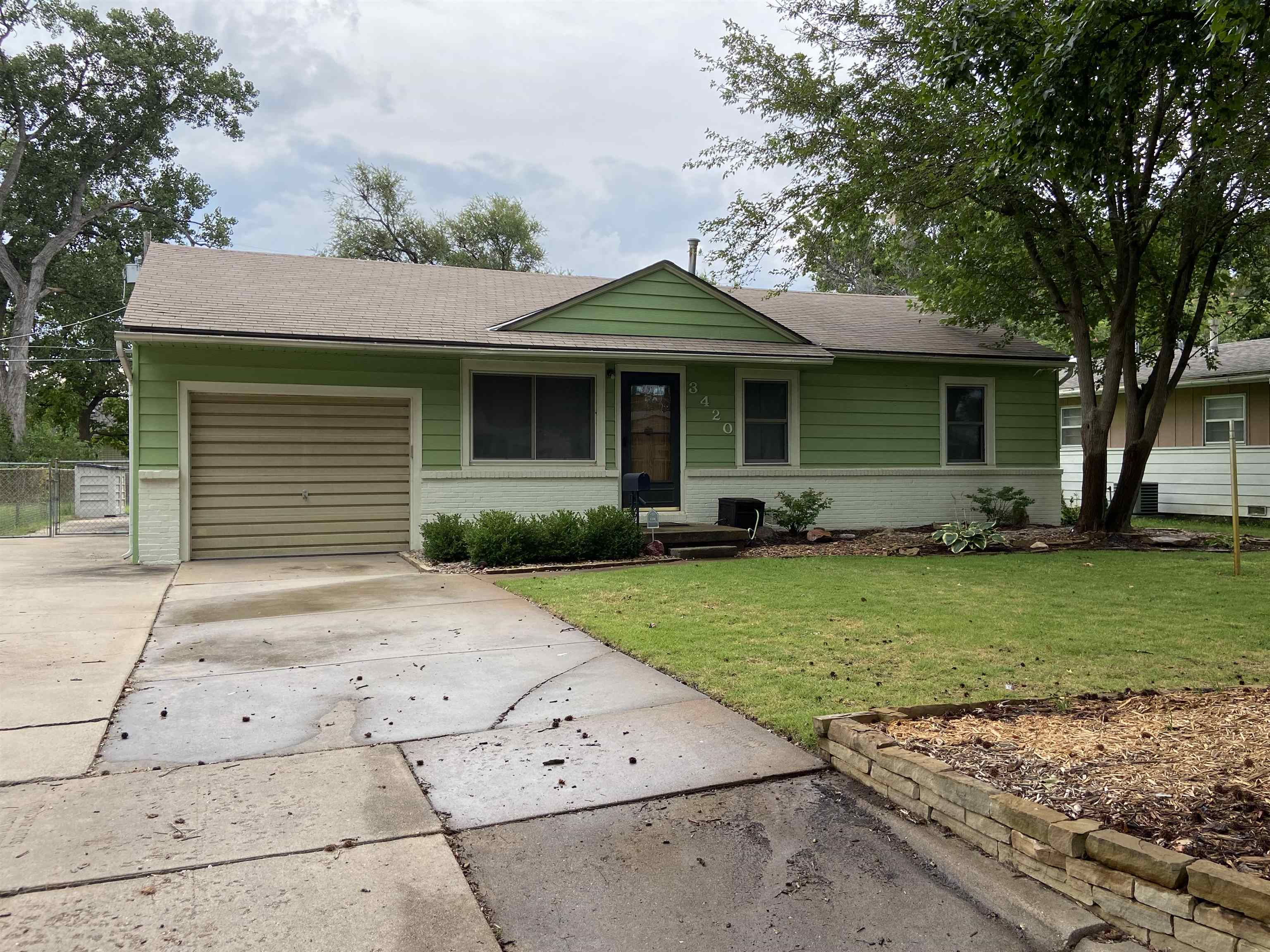 This beautifully landscaped & well maintained home boasts a large family room that leads out to the
