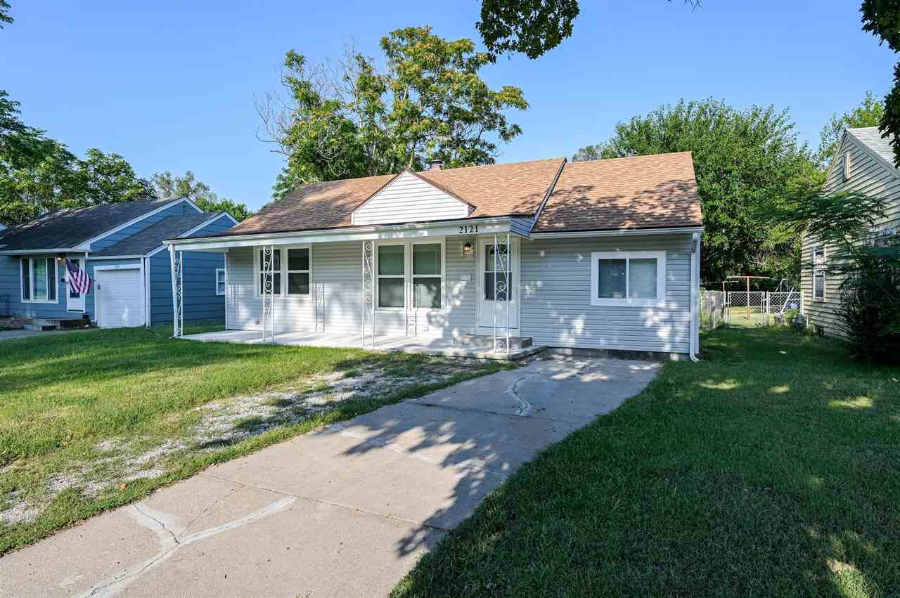 TURN KEY READY HOME! Beautiful house that is on a quiet street with plenty of space, personality, an
