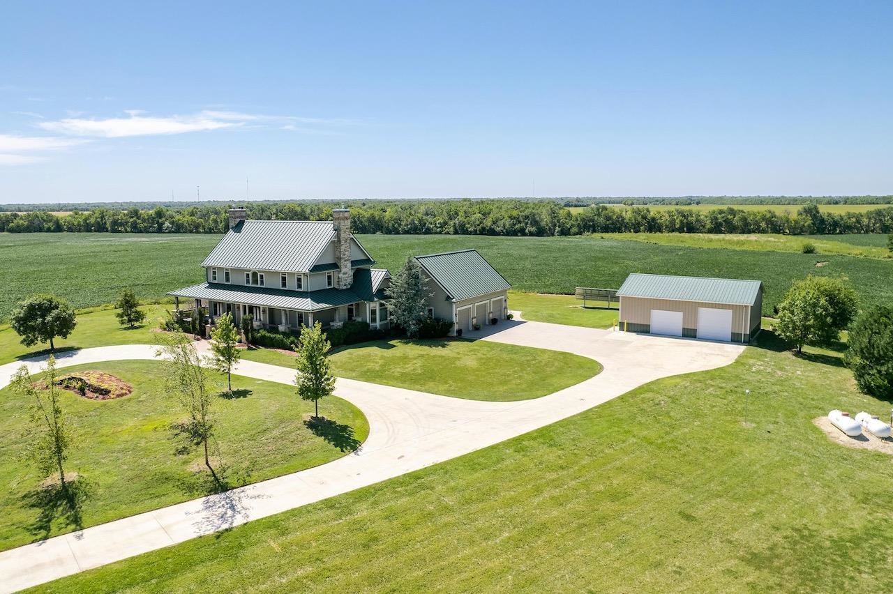 4 Bedroom 4 1/2 bath home on 39+- acres with a 1.5 acre stocked pond and approximately 36 acres of t
