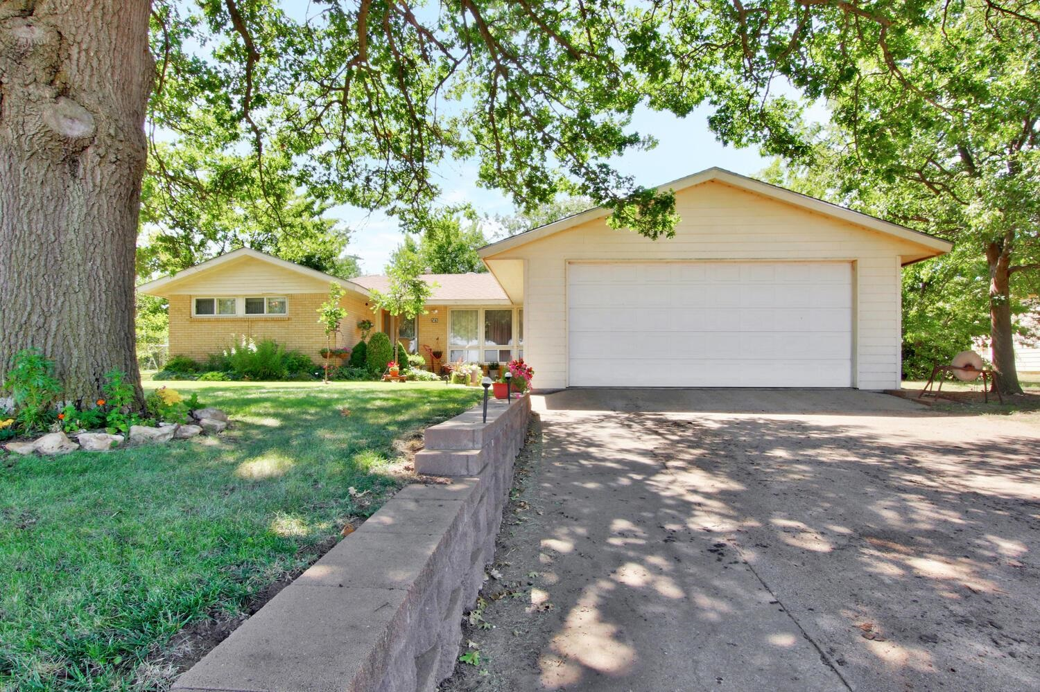 Welcome Home! This is a must-see for everyone. Well-maintained home in Norwich, Kansas--an easy 15-minute drive from west Wichita. You'll love small town living in this unbelievably spacious, full brick home! You'll be welcomed by beautiful landscaping and a small shaded patio where you and your family can slow down from the hustle and bustle of life and enjoy your time at home. You'll feel at home as you step inside the house and see the great layout coupled with gorgeous hardwood floors and lots of natural light. Just when you think you've seen it all step outside the kitchen door into another large family room and full basement that could be finished off for added square footage. This 3-bed/2-bath home offers unlimited options and sits on a large lot. Call for a showing today, it won't last long!