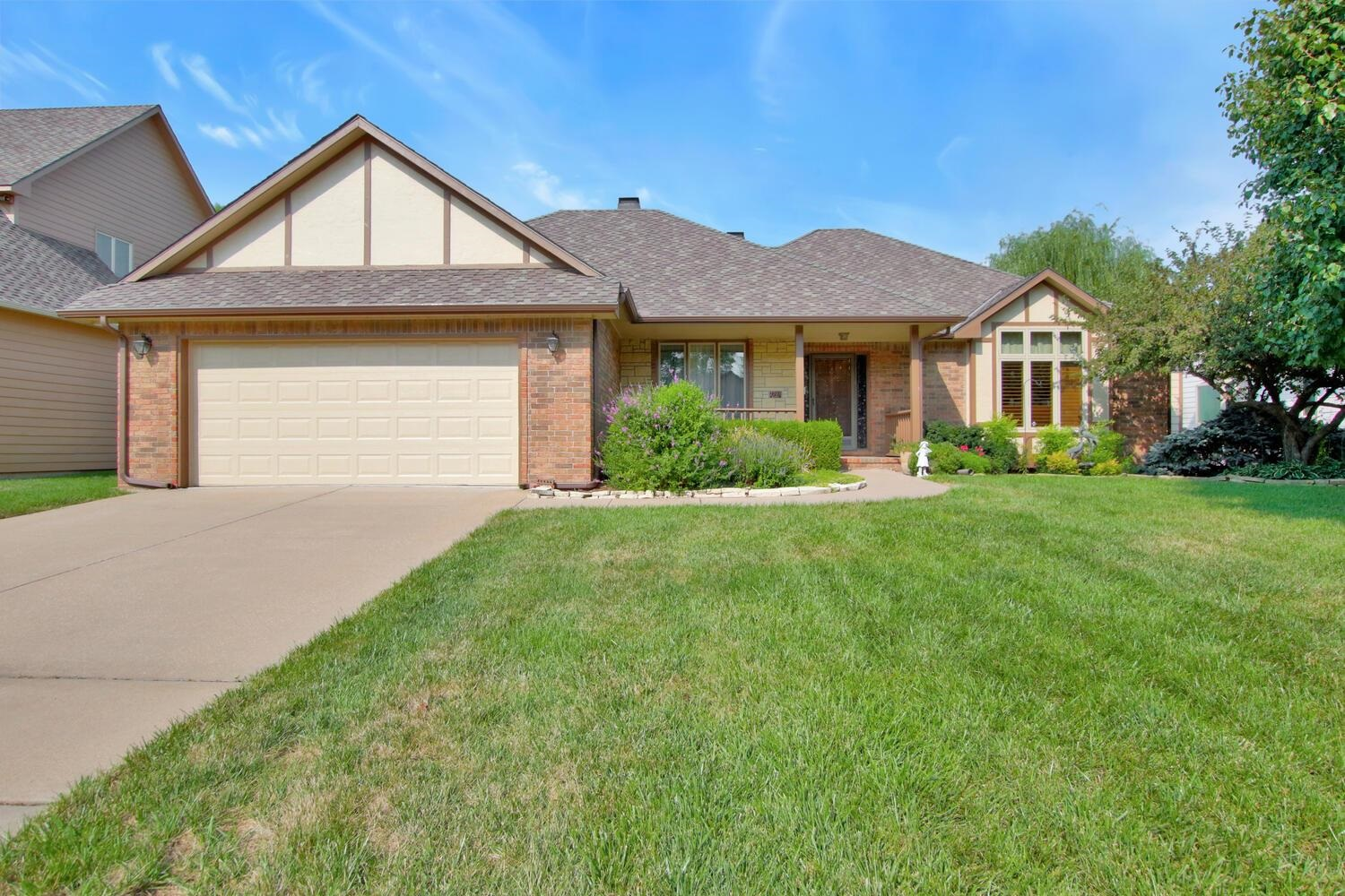 Lovely, open ranch home has been impeccably maintained.  Fantastic wood floors in kitchen, hearth, living room and formal dining area.  The back deck affords two entrances, one through kitchen and the other through the Master bedroom.  Deck is mostly covered and also has roll up blinds to shield from the sun.  Also has high end deck flooring.  Enjoy your cup of coffee and listen to the fountain as you peer out over the neighborhood pond.  Absolutely huge rec room that has a wet bar, gas starter fireplace and walk out/walk up exit.  Sunken patio has room for more entertaining areas.  Two more large bedrooms, two storage areas, with one having an escape window should you need bedroom #5!  Updates include new HVAC in 2020, newer Presidential roof, all window with exception of protected windows in dining and hearth room and MB slider have all been replaced with Pella window.  Beautiful landscaping and fenced in with wrought iron.