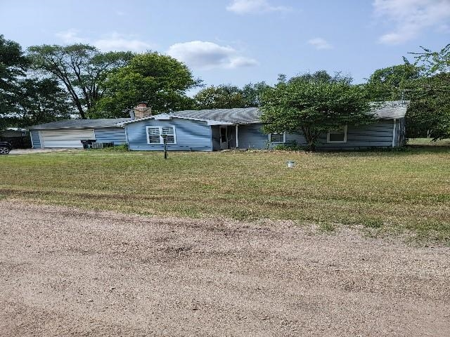 Welcome home to this charming home just outside of the city limits.  Boasting 4 bedrooms and 2 full