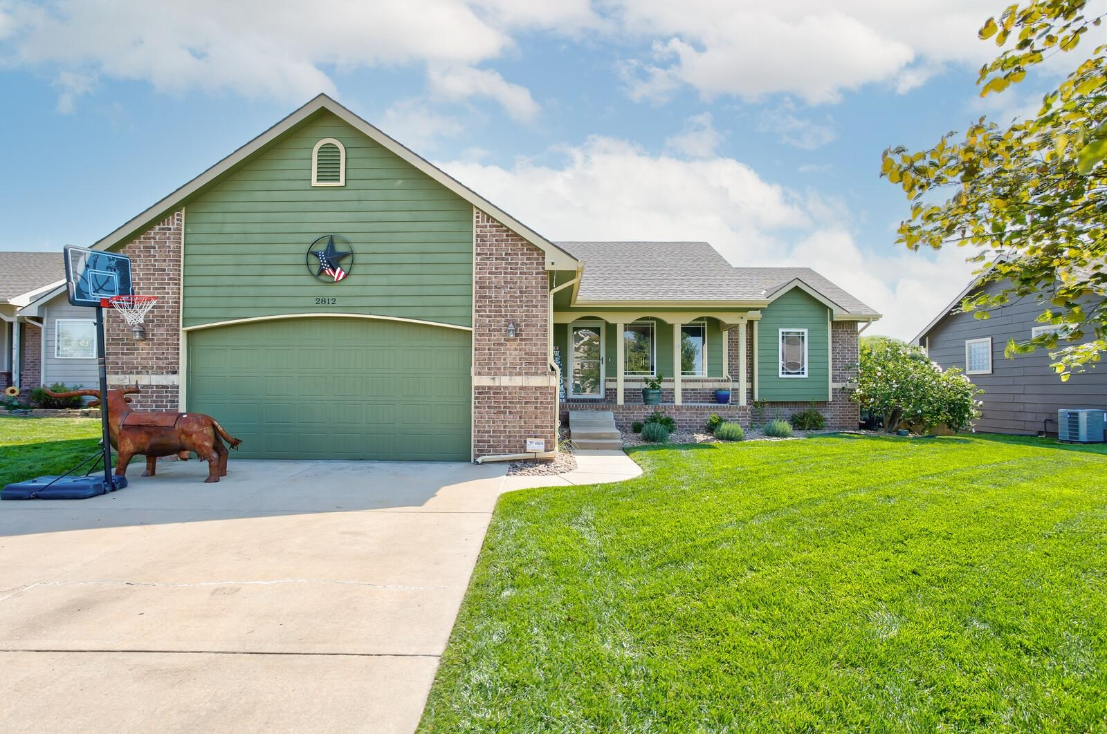 Wow, check out this amazing Derby home! 4 bedrooms (with a 5th option), 3 baths, 2400+ sq ft with an