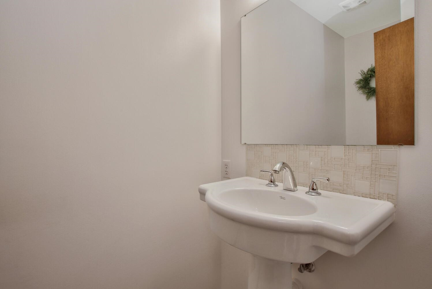 Pedestal sink in half bath.