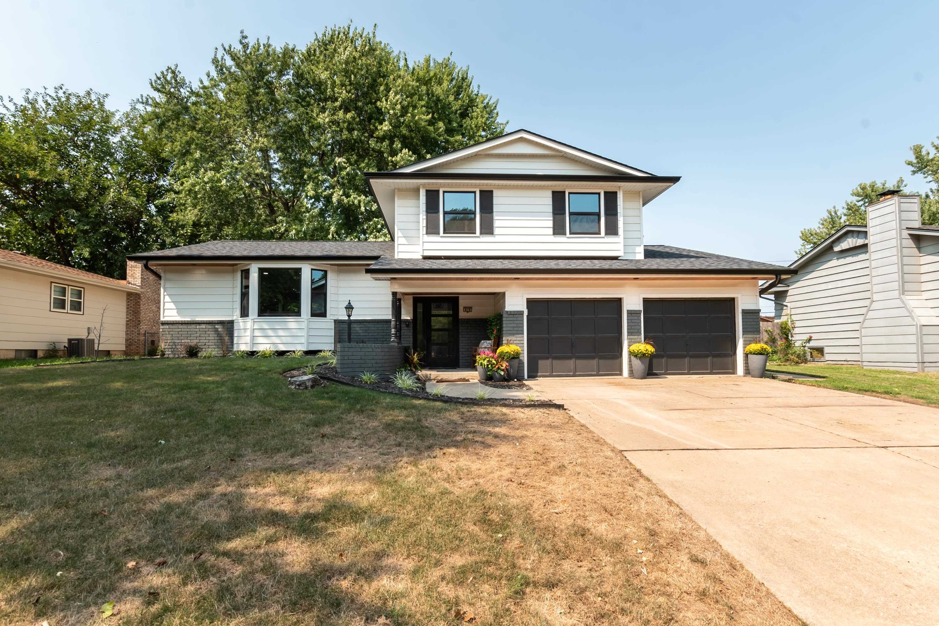 Completely remodeled and stylishly updated 3 bedroom, 2.5 bath home in Derby. Striking curb appeal g