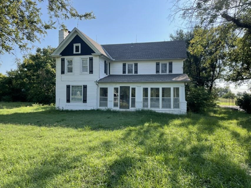 Here is an amazing chance to buy 10 acres and be close to the city.  Beautiful farmhouse located jus