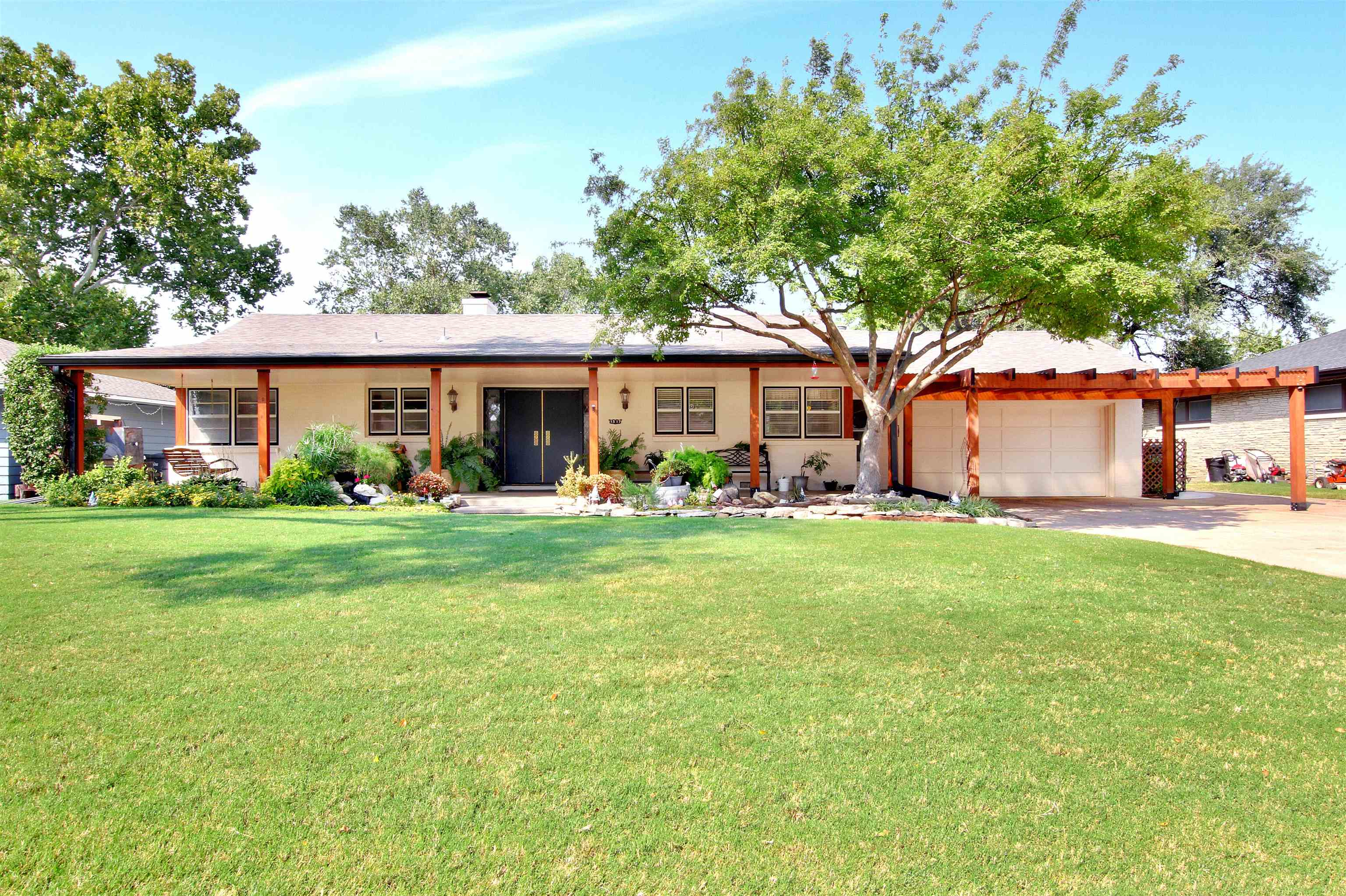 You won't want to miss this listing!  The home has original, mid century features that have been wel