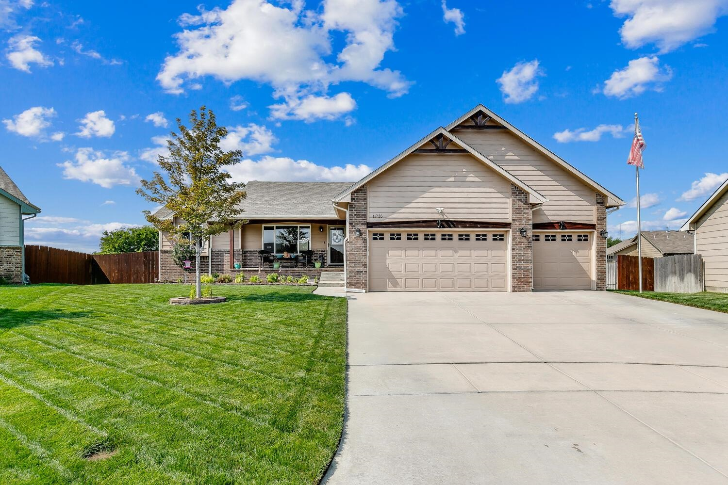 Hurry on this one!  Beautifully designed 5 bedroom, 3 bath split ranch with lush yard, meticulous la