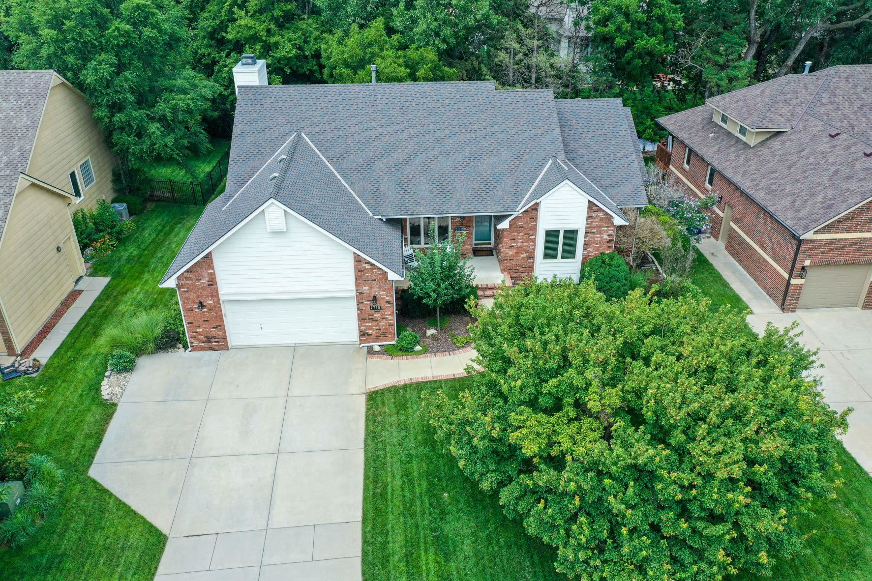 Completely updated and remodeled home in Reflection Ridge, with popular Maize South schools, featuri