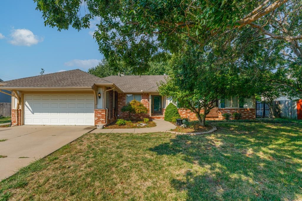 Welcome home to this spacious 4bed/3bath/2car ranch in northeast Wichita. This home is one of the la