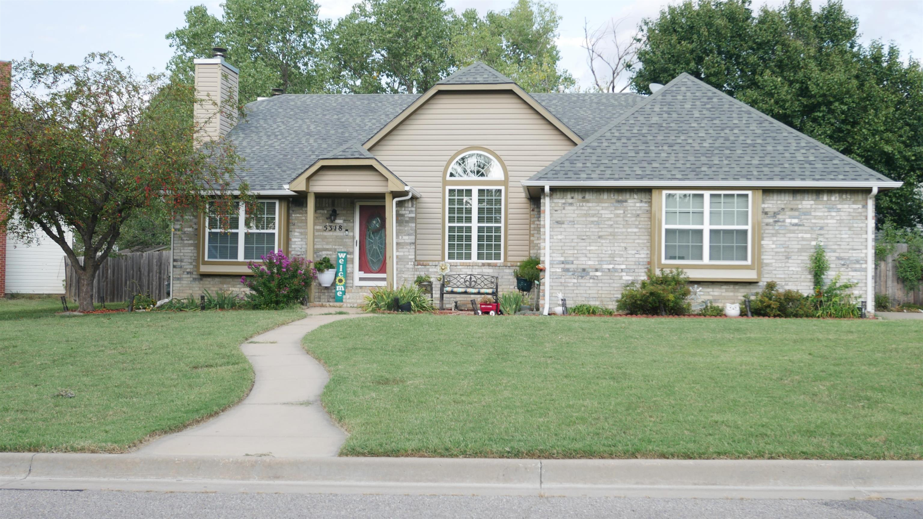 This 4 bedroom, 3 bathroom quad level home features a covered entry and an attached side load two ca