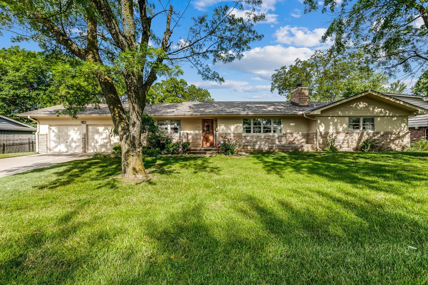 Great brick and stone mid century home with uniqueness and charm. Gorgeous wood floors throughout ho
