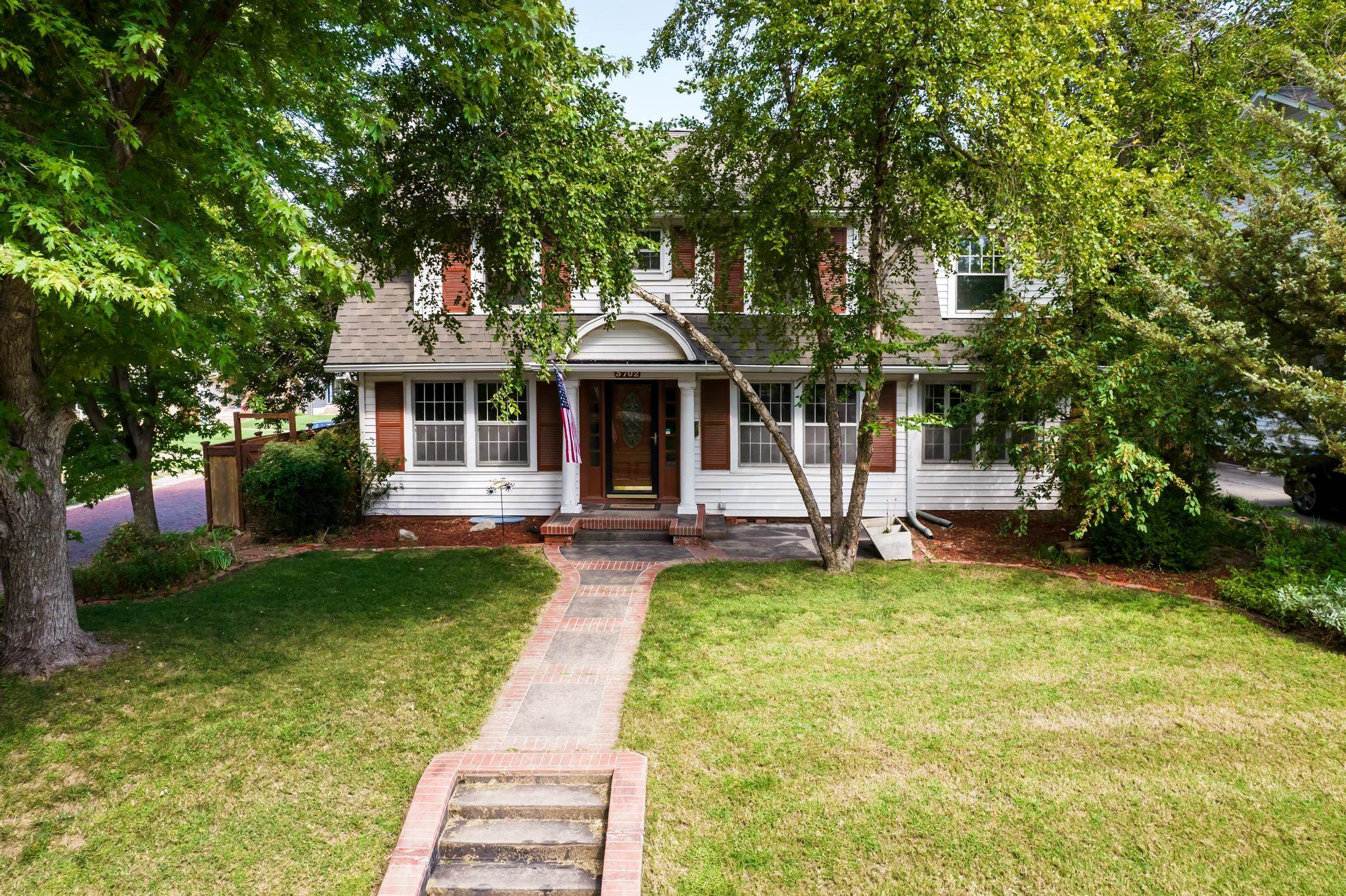Charming two story situated on a corner lot complete with a versatile floor plan, lovely living room