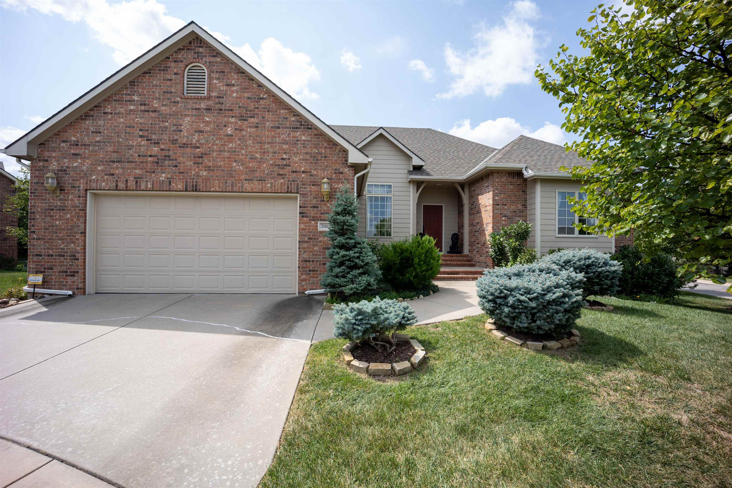 This immaculately maintained patio home is situated on a corner cul-de-sac lot and features a great