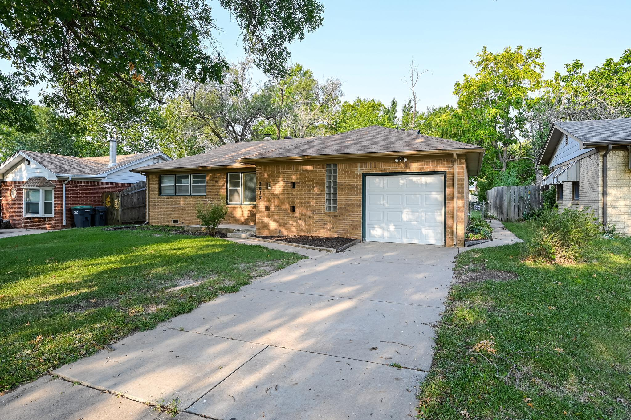 Gorgeous all brick home, in quiet area with plenty of mature trees. This home is a PERFECT first hom