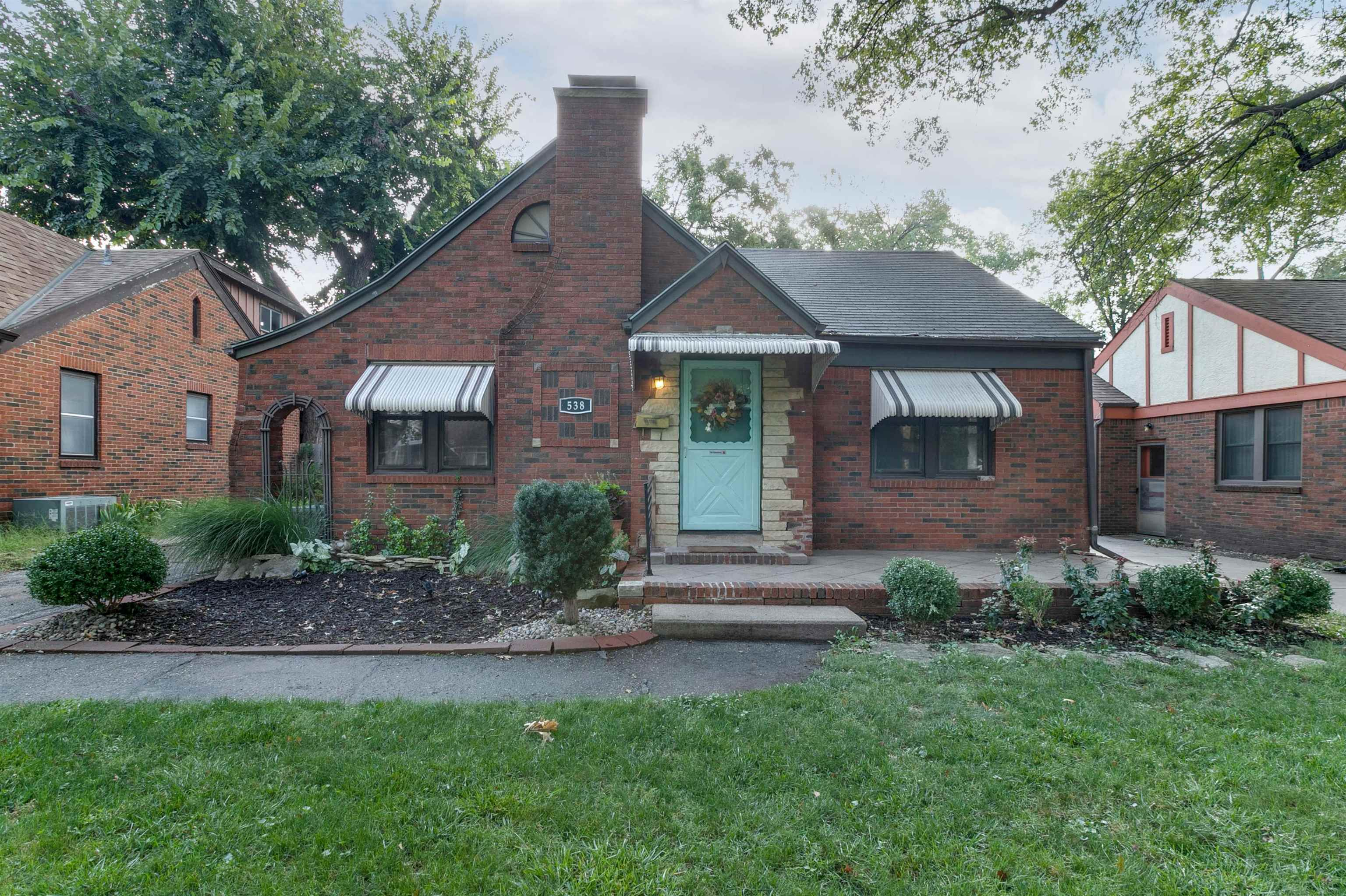 Darling centrally located full-brick tudor style home with more charm than you could ask for! You wi