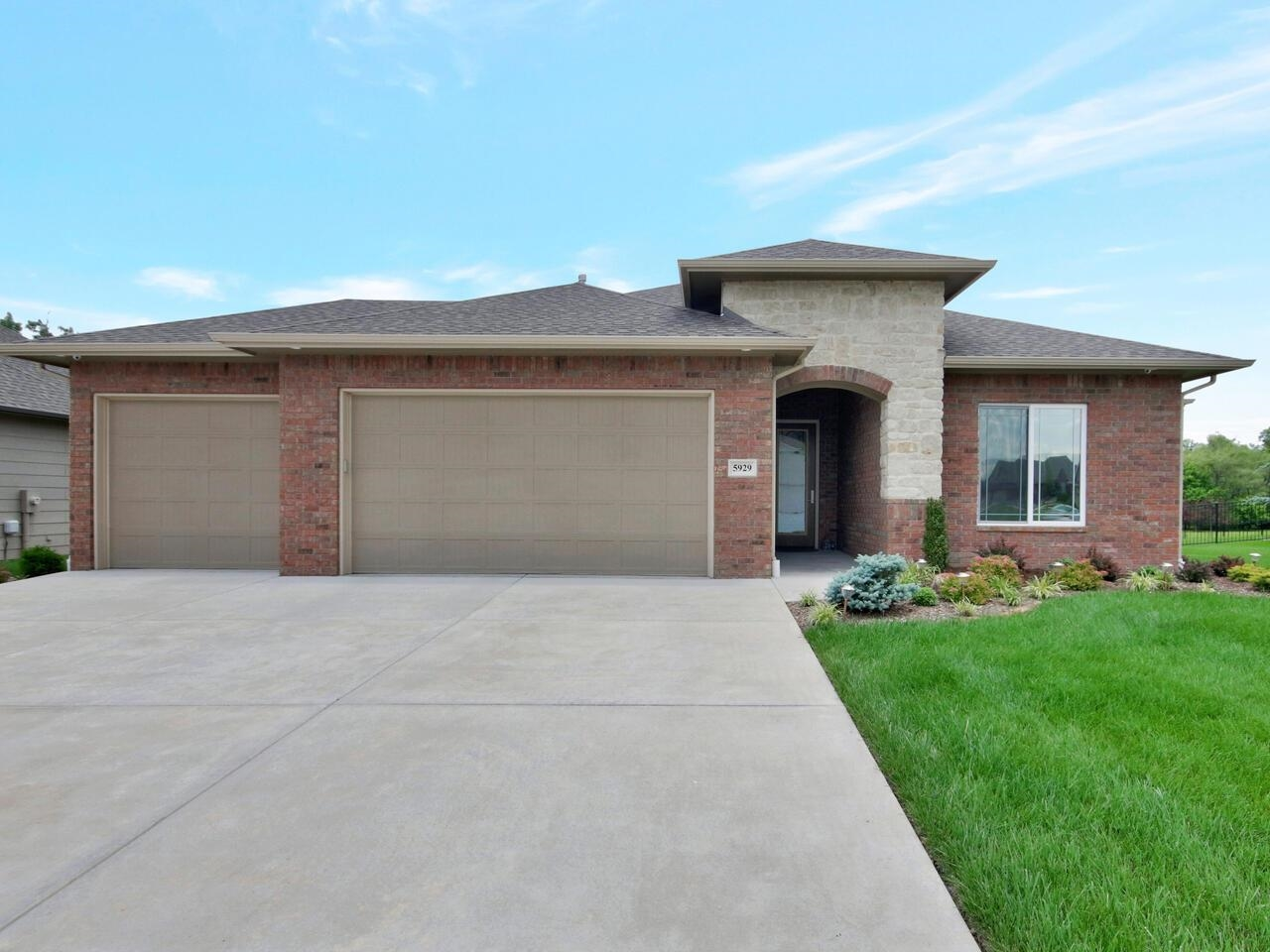 BETTER THAN NEW! Pristine zero entry home located on a beautifully landscaped half acre lot with a f