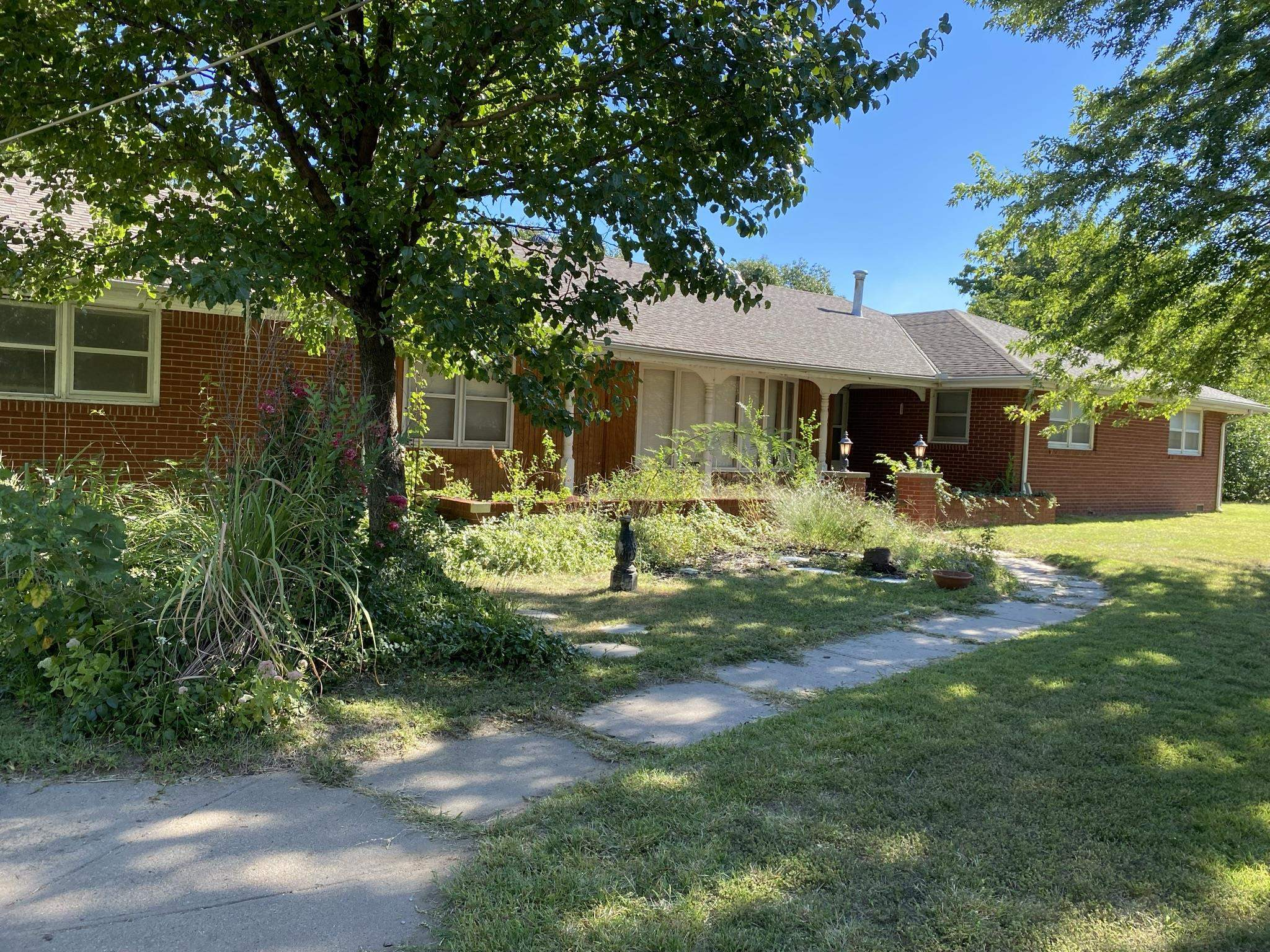 This is a rare find. Over 2,200 sq ft full brick ranch on over 1/2 acre corner lot. Open kitchen to the dining area, master bedroom with a full master bath. 1/2 bath off of the garage.