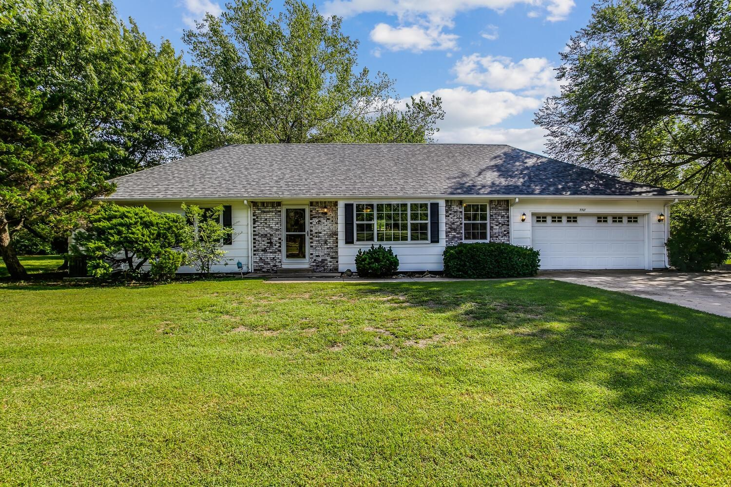 This wonderful and perfectly located home is a rare find! With the gorgeous backdrop of mature trees