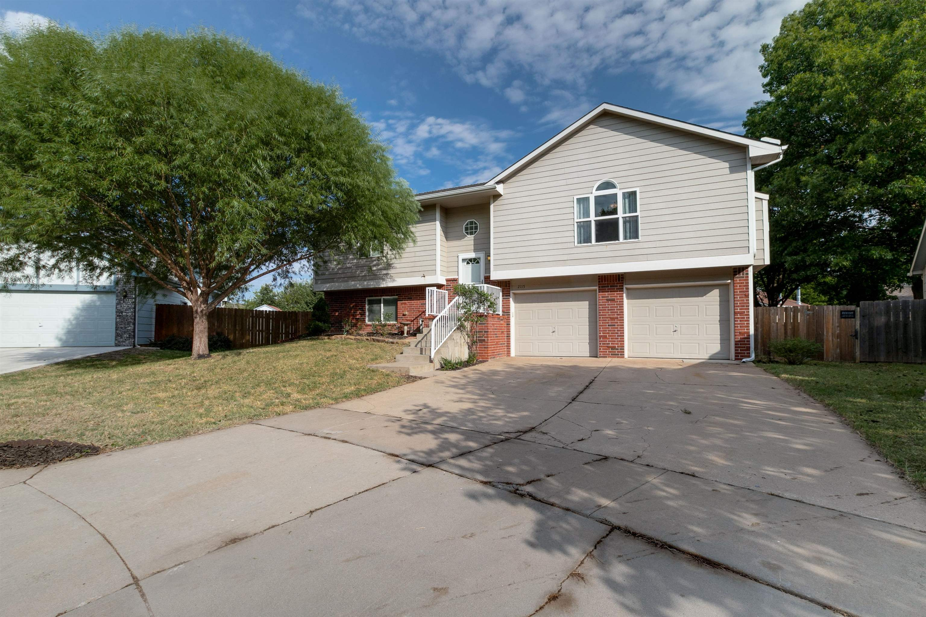 This 4 BR home is  in the Maize School district on a cul de sac with large fenced backyard.  The kit