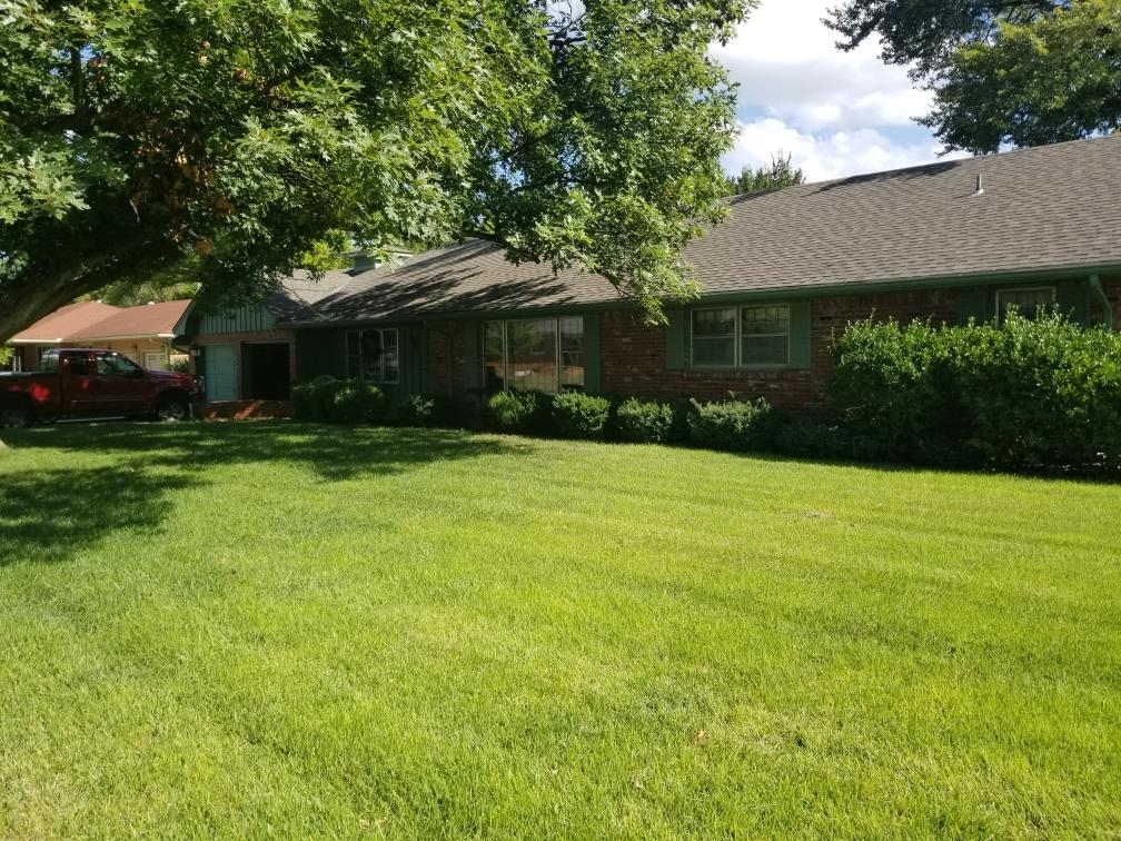 Brick home with curb appeal.   Large rooms, fenced back yard.   Irrigation well.  Corner lot.  Walk in tub, family room fireplace, laundry on main floor, fenced yard lots of shade.   Lots of space to live in.