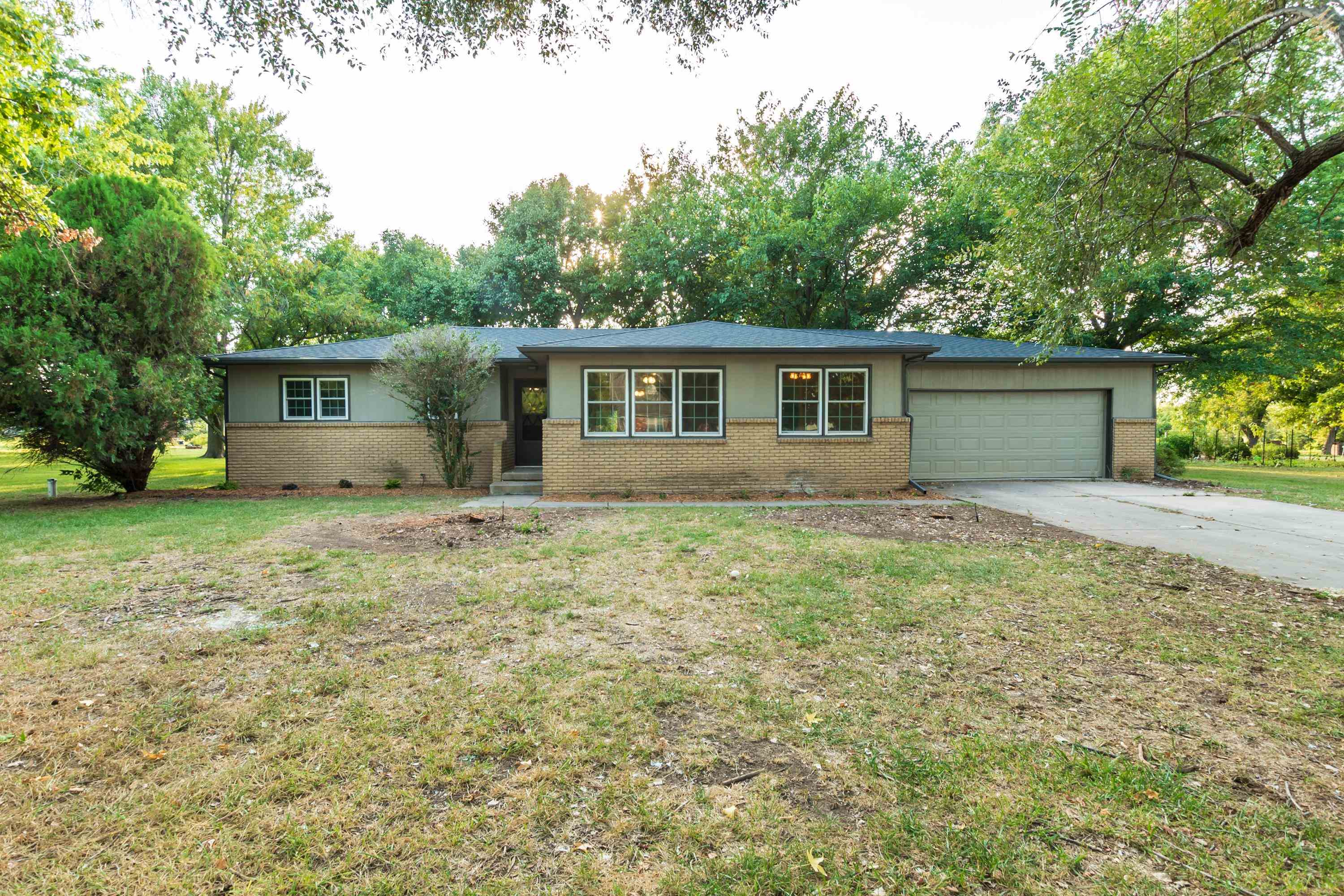 Country feel, city convenience! Total remodel in this 3 bedrooms, 2 bath sprawling ranch offers the