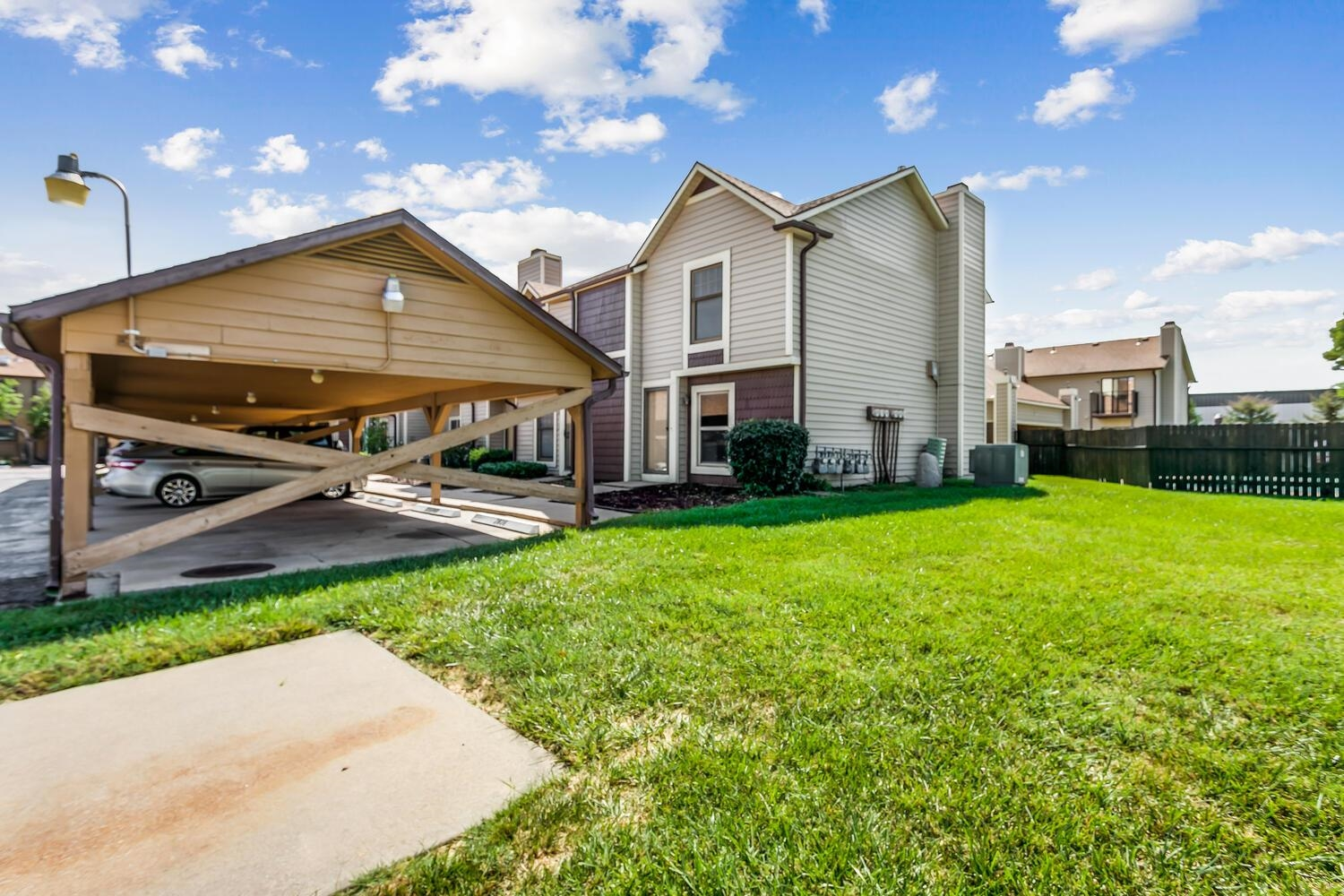 MOVE IN READY EAST SIDE HIGHLANDS CONDO WITH CARPORT! THIS CONDO FEATURES NEWER CARPET AND NEUTRAL P