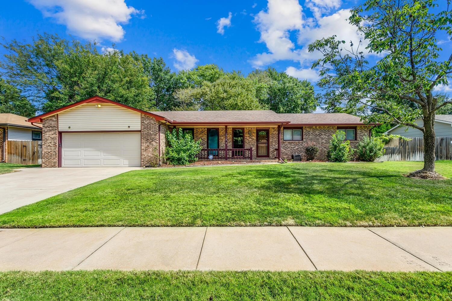 SPACIOUS RANCH IN ESTABLISHED WEST SIDE NEIGHBORHOOD. KITCHEN HAS AN ABUNDANCE OF CABINETRY AND IS O