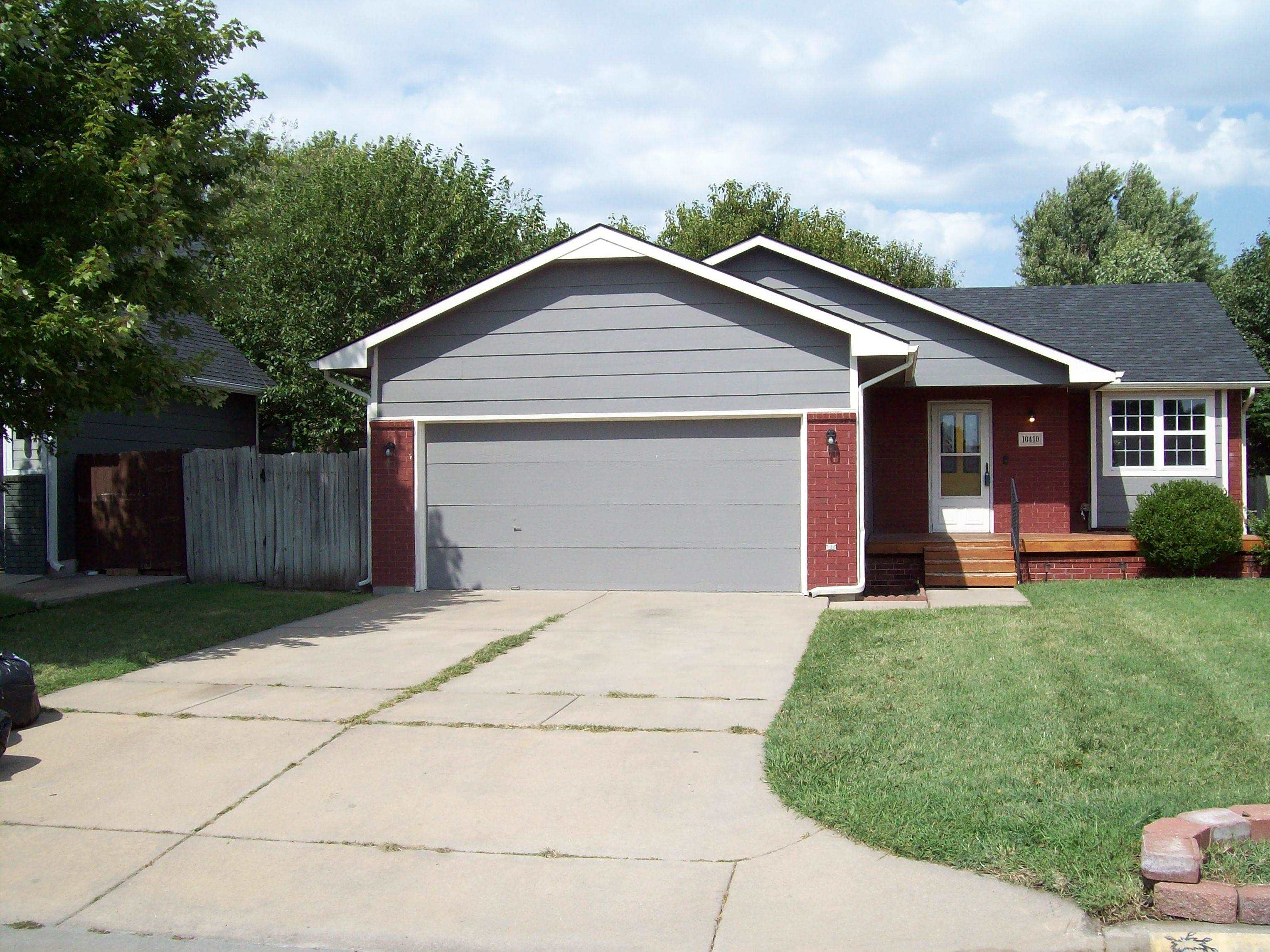 4 bedroom Ranch with finished basement. 2 car garage, large front porch and covered deck and patio.