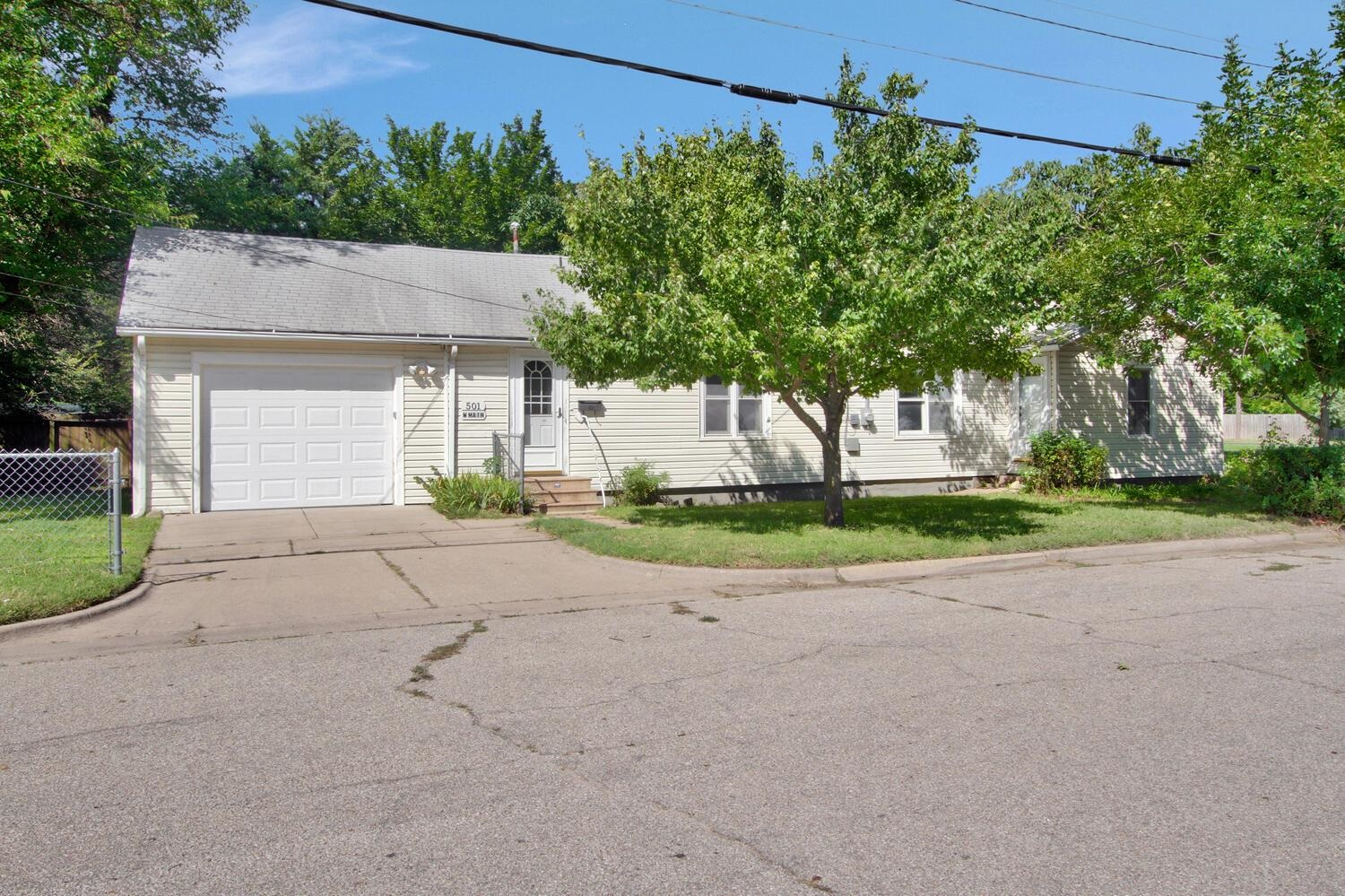 Nice 2 bedroom 2 bath ranch with a 1 car garage nestled on a corner lot with many mature trees. Feat