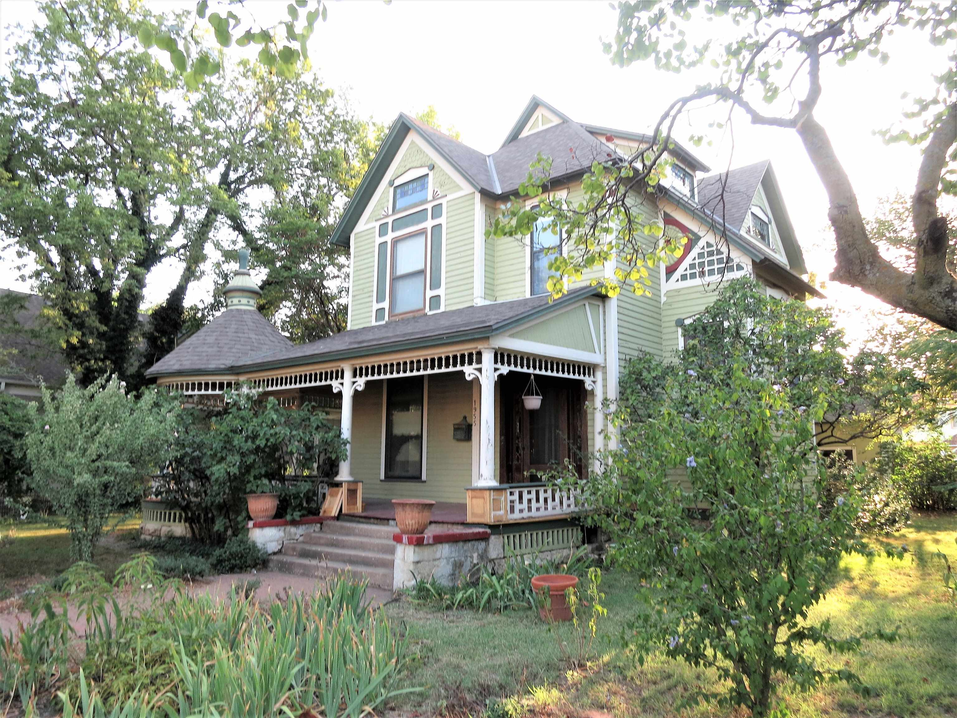 This Queen Anne style home with amazing architectural details is listed on the Wichita register as t