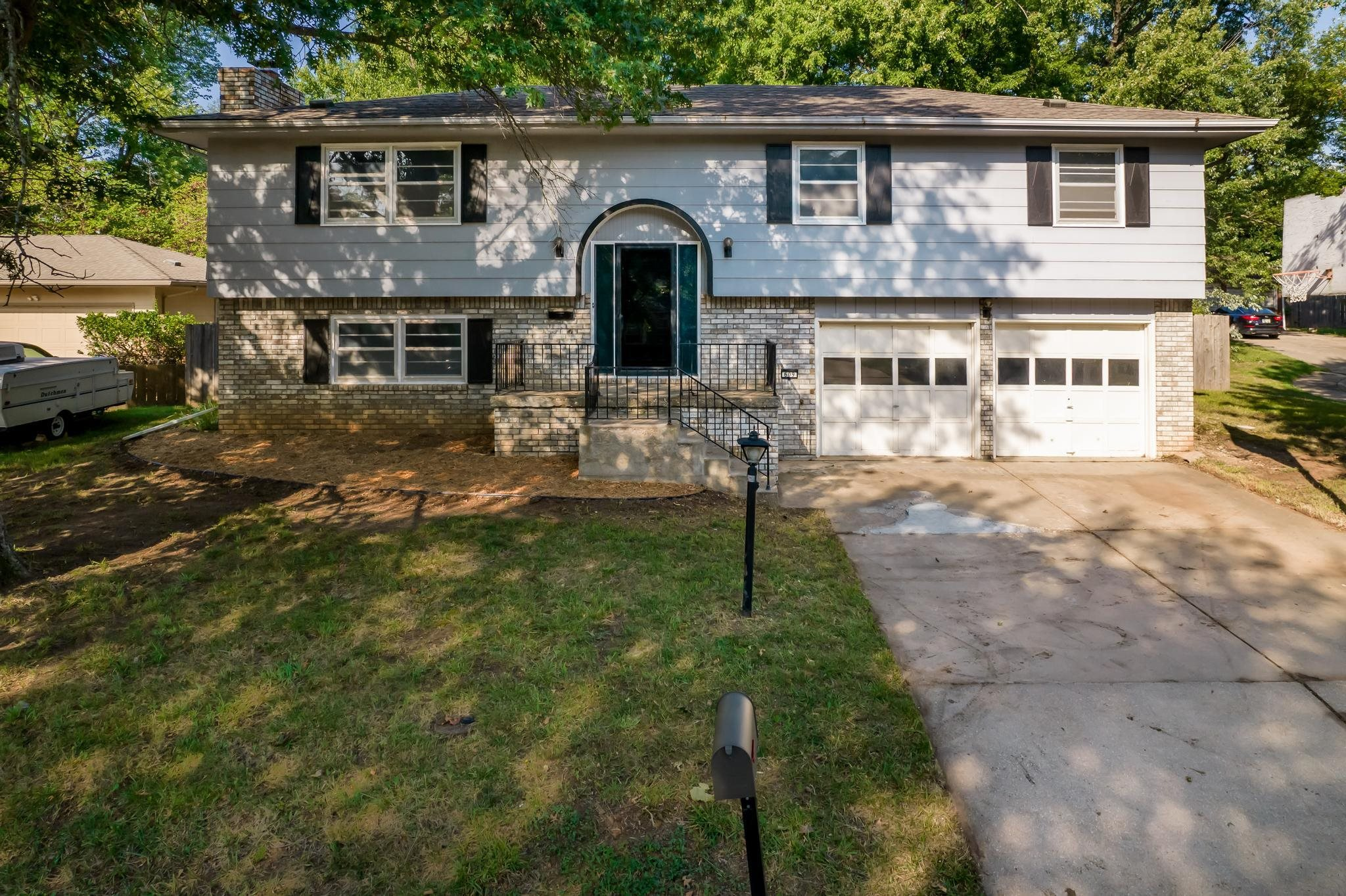 Welcome Home to 609 N. Willow Dr in Derby, Kansas. This 4 bedroom, 2 bathroom home is situated on ma