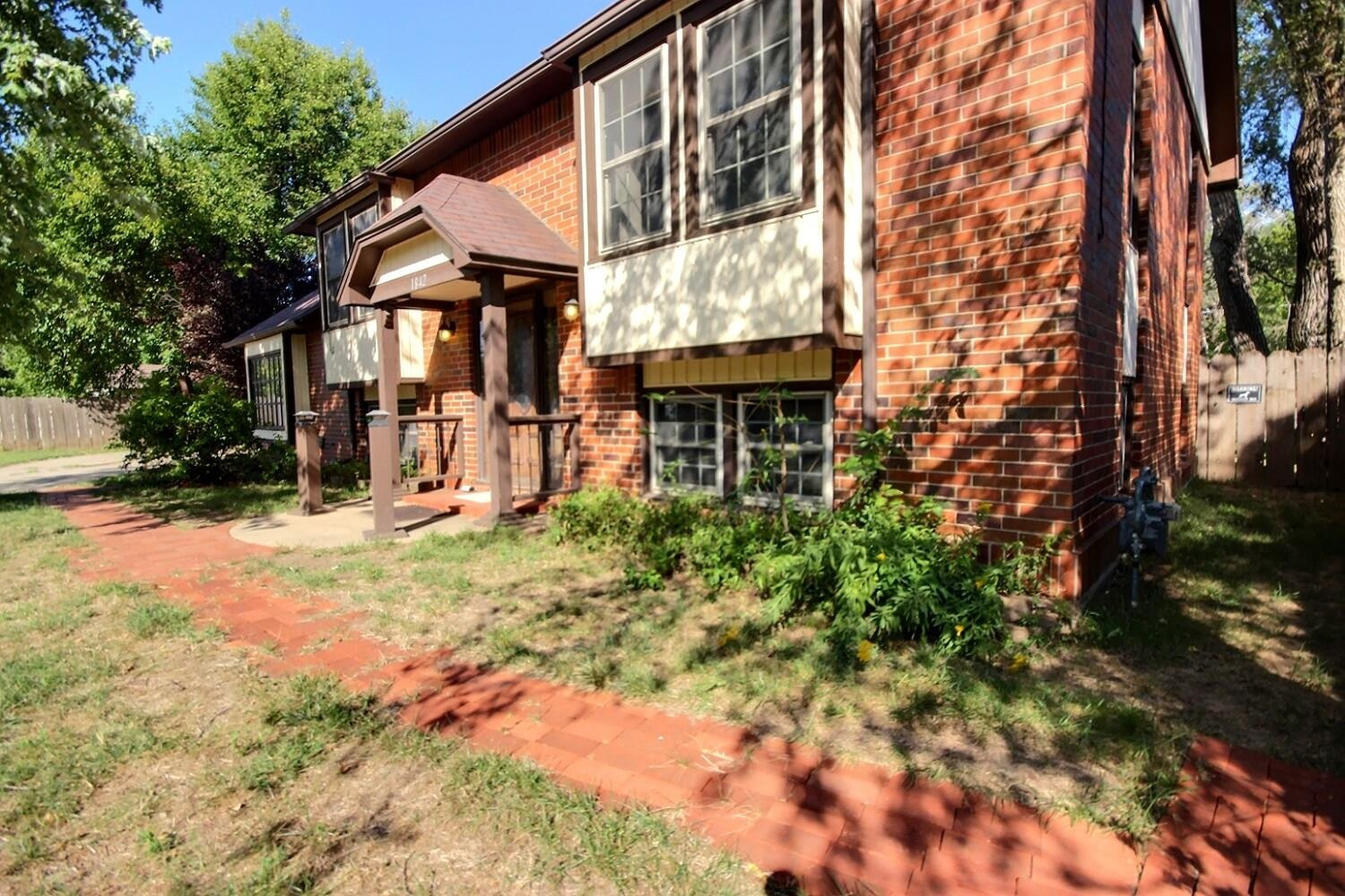 This handsome Tudor style home on 1.5 lots -- and no HOA or specials -- could be yours! 4 bedrooms,