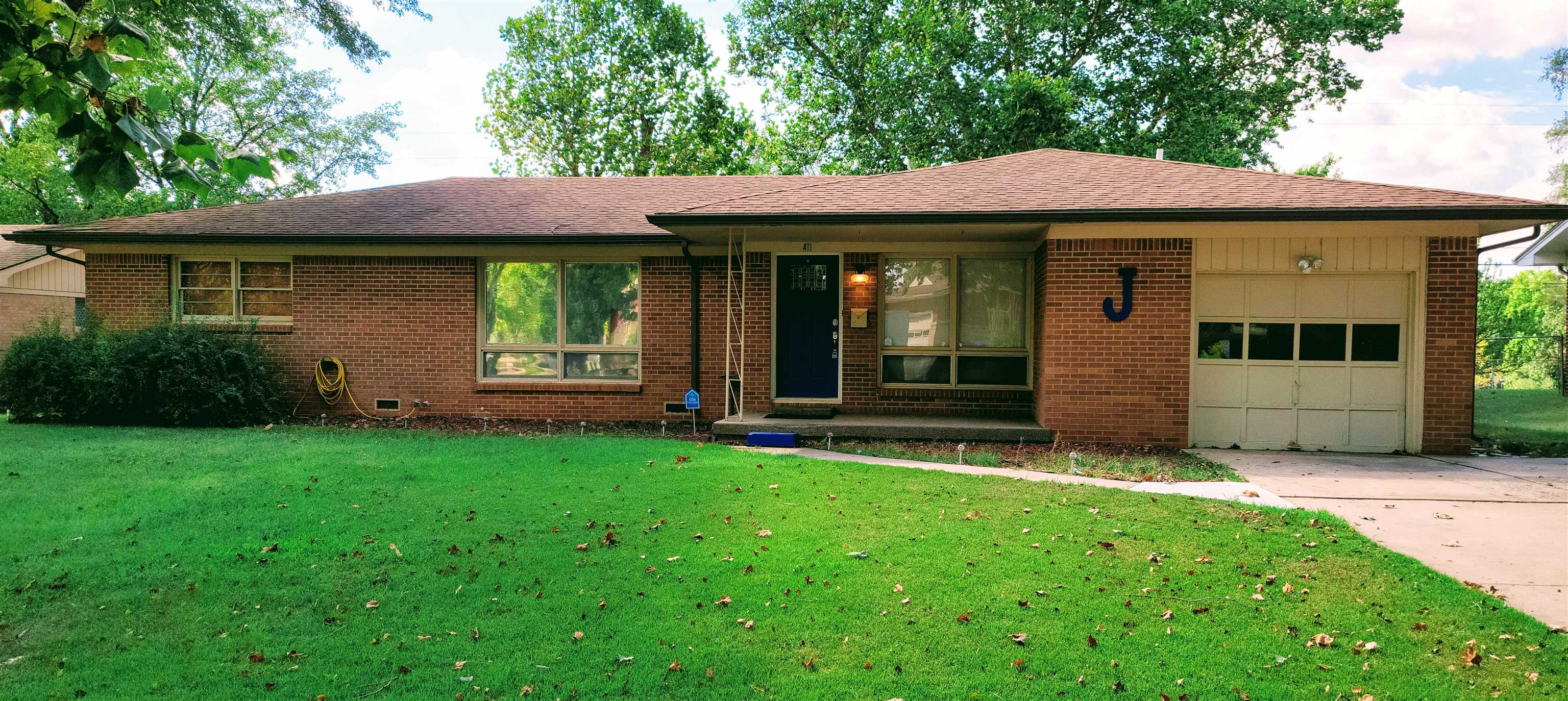 Welcome to this lovely 3 bed, 2 bath home that sits on a quiet street in west Wichita! This home bac