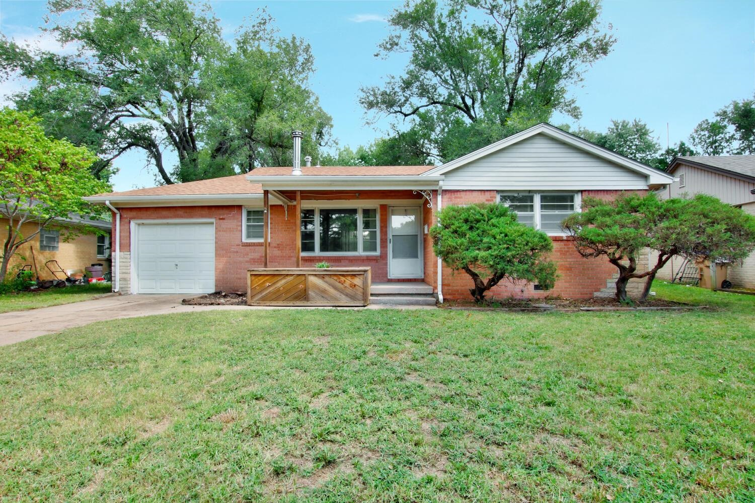 Come see this all brick ranch home right in the heart of Derby! Home includes a spacious living area
