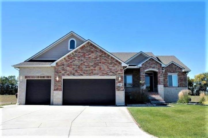 Don't wait a year to build when you can have this like-new home today! This home is situated on a qu