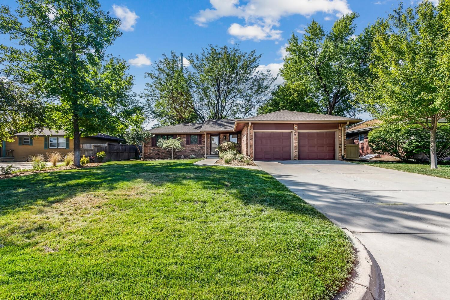 With the gorgeous backdrop of mature trees and accented by incredibly detailed landscaping, this ful