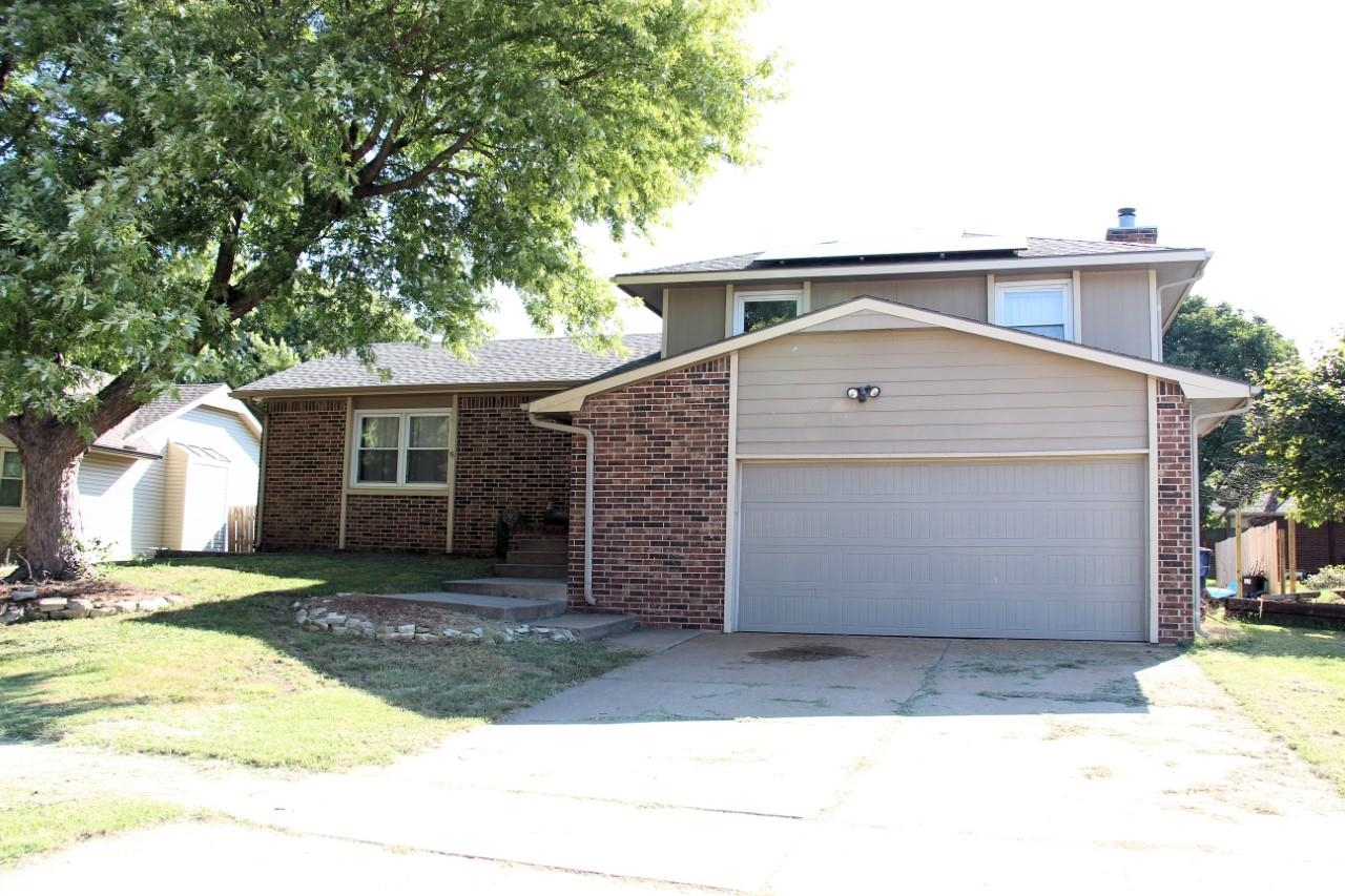 Beautiful, updated 3 bedroom, 2.5 bath split level home on quiet street in East Wichita. Large livin