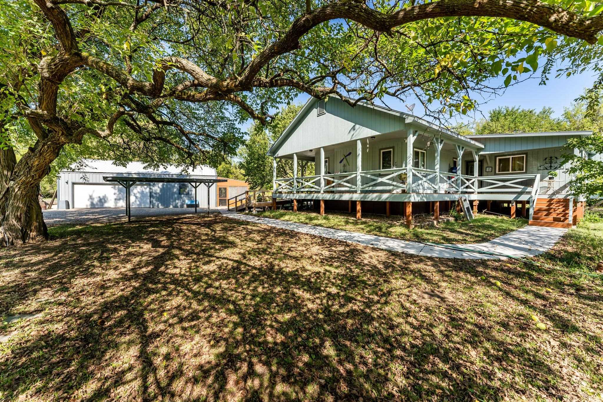 Beautiful 7.5+ wooded acres on the Arkansas River! Main home is 2,160 sq. ft., and is 2-bedroom 2-ba