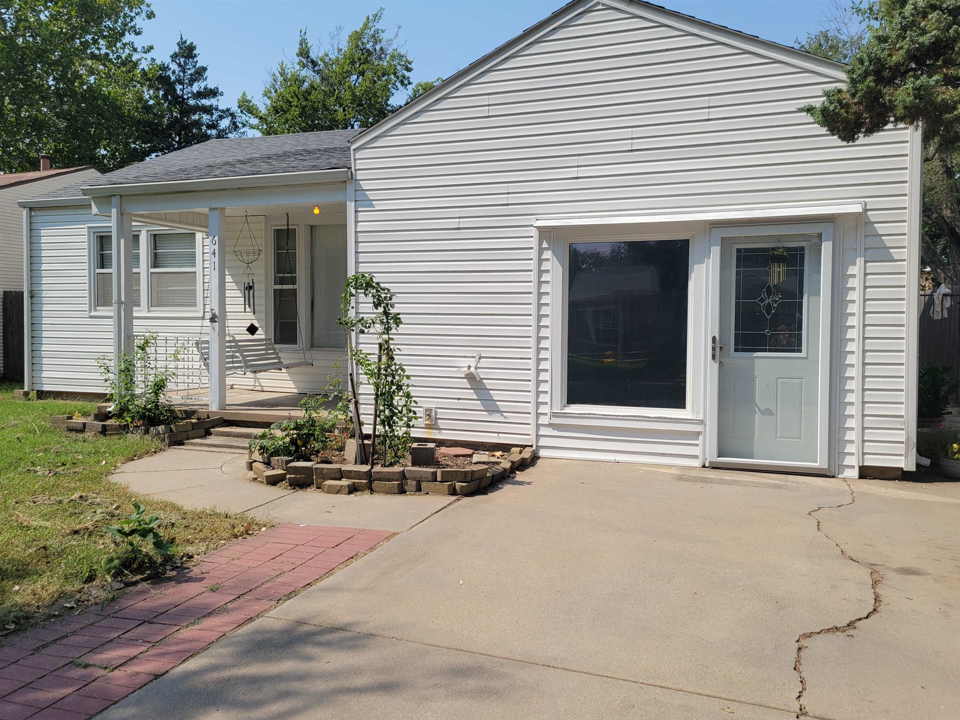 Move in ready on this wonderful ranch home. With 3 bedrooms and 2 full baths. Bonus room can be converted back into a 1 car garage. New Fridge installed about 2 years ago including the toilets and HVAC units.