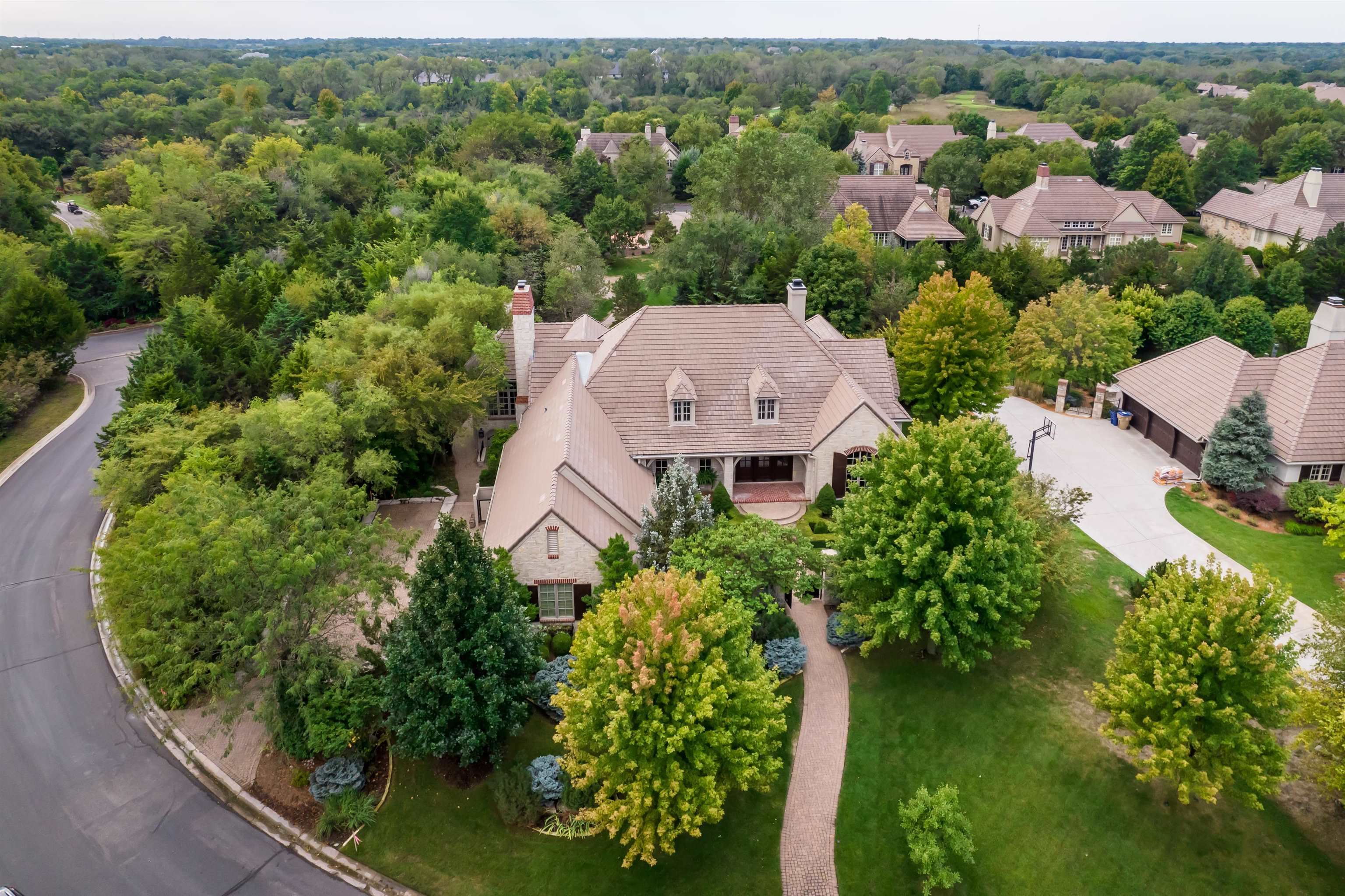 An amazing French country estate in beautiful Flint Hills National can be yours! Custom built estate