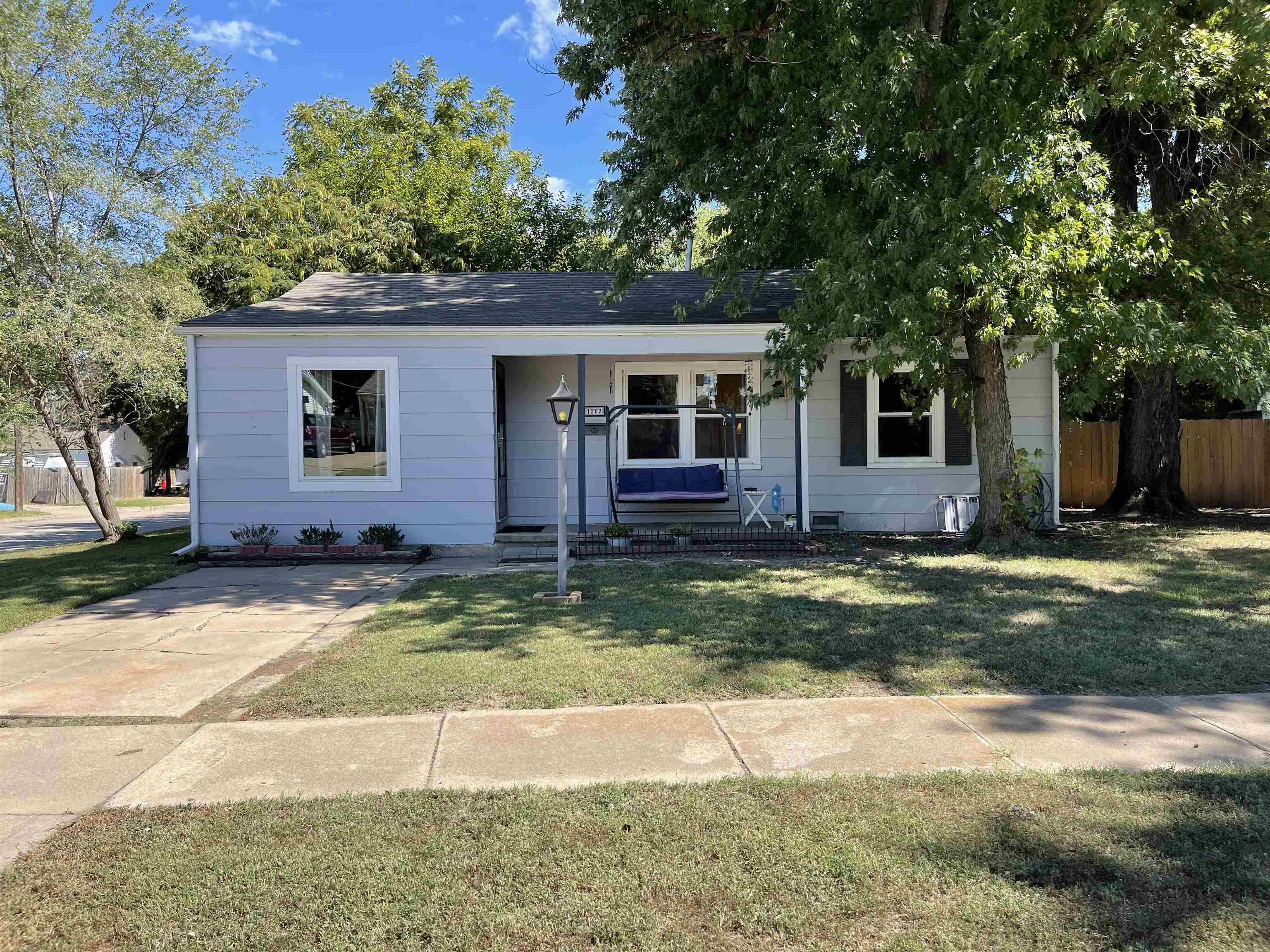 Lovely ranch style home with 3 bedrooms ready for a new owner!  Corner fenced lot with oversized det