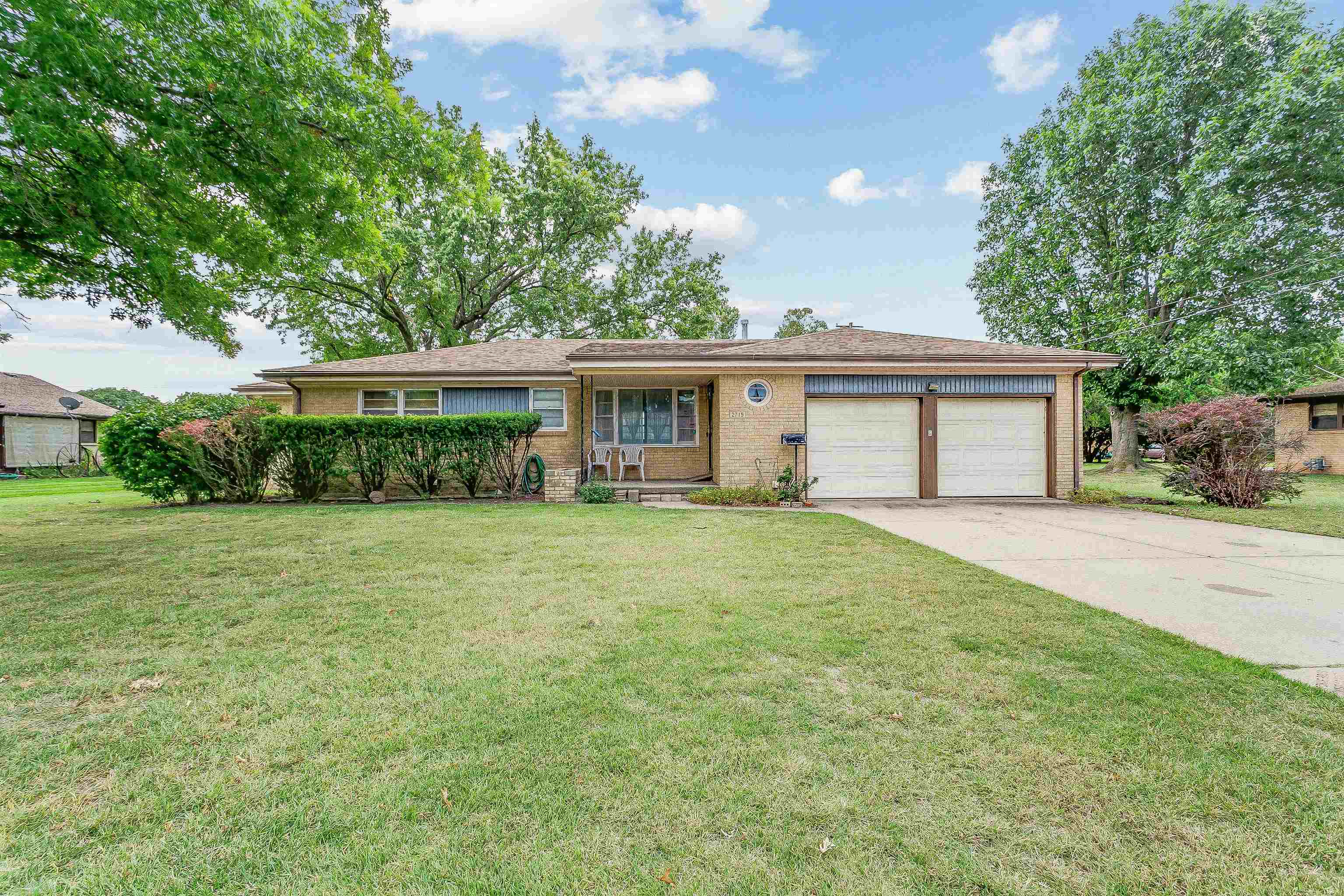 Spacious 3 bedroom, 2 bath full brick ranch home with main floor family room and partial basement.